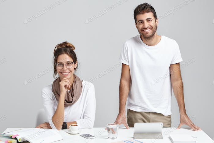 Professional male and female workers being in office, work on modern cyber technologies project, sha