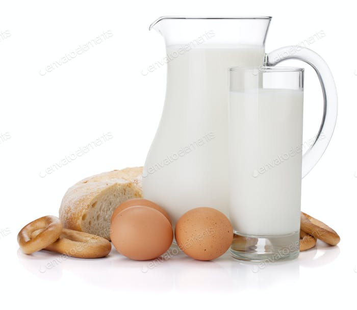 Milk jug, glass, eggs and bread