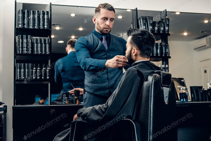 Men's beard grooming with the electronic beard trimmer.