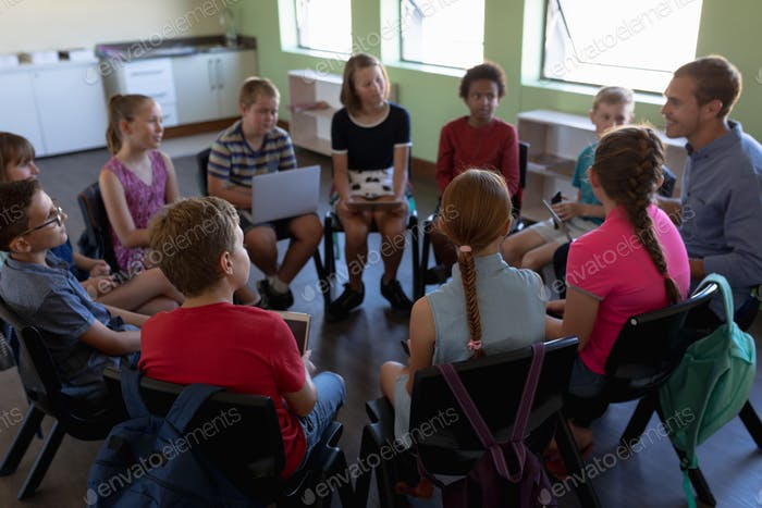 Group of elementary school kids sitting in a circle