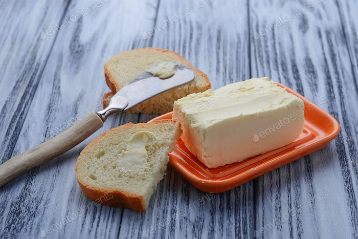 Fresh butter, bread and knife