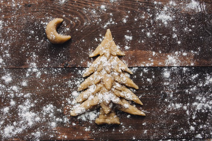 Christmas tree and moon baking rustic background