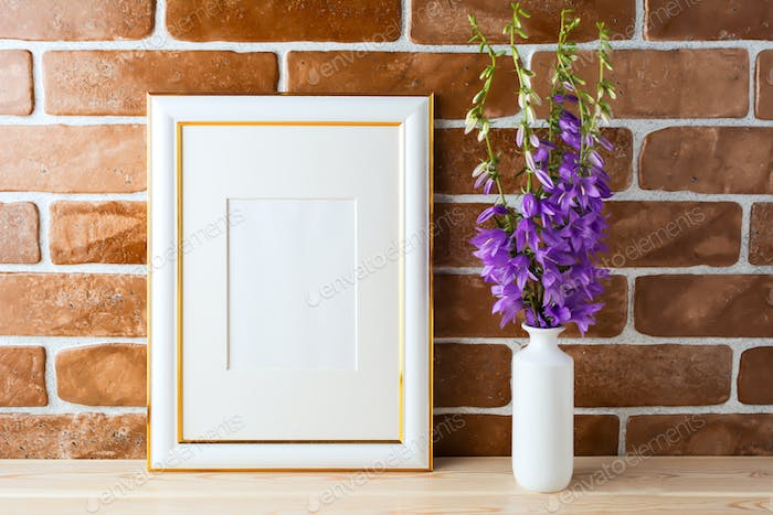 Gold decorated frame mockup with bellflower bouquet exposed bric