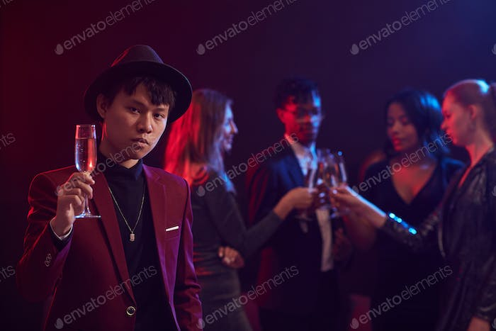 Asian Man Posing in Nightclub
