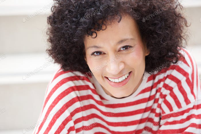 Close up smiling african american woman in her 30s