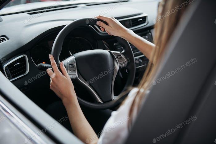 Female driving car.