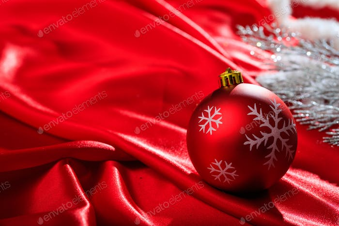 Christmas ball on red satin