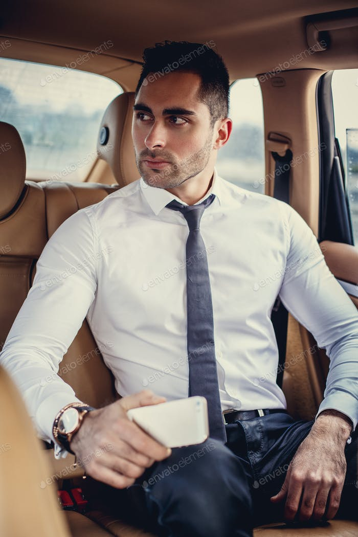 Serious business man in a white shirt.