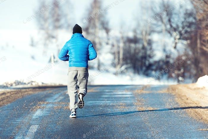 Fitness man, jogger running, preparing and training outdoor