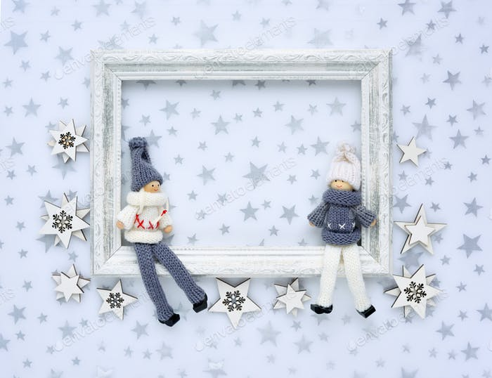 Photo frame, christmas decorations on a background with silver stars