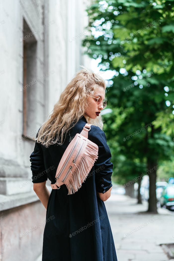 Blonde woman with a bag