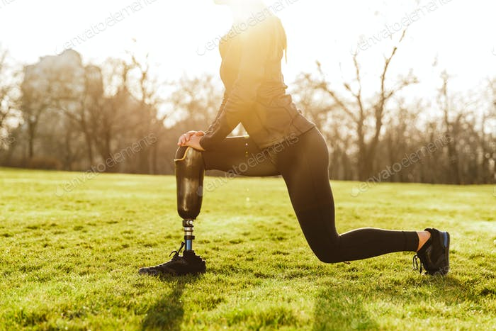 Cropped image of disabled athletic girl in black sportswear, doi