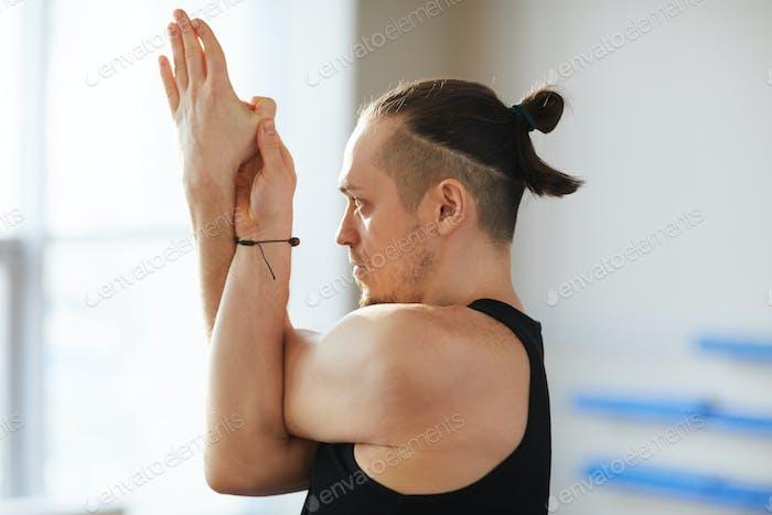Yoga pose including eagle arms