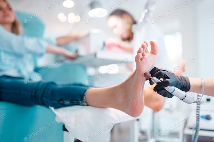 Beautician salon, foot polish procedure
