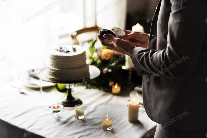 Man Hands Holding Wedding Cup Cake on Reception Banquet