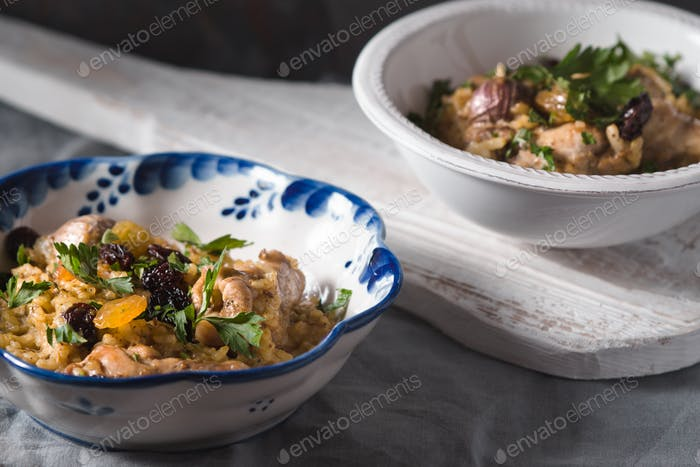 Pilaf in ceramic bowls side view
