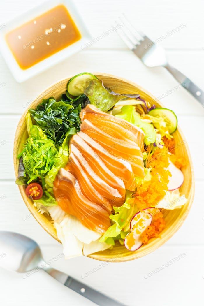 Raw fresh salmon fish meat sashimi with seaweed and other vegeta