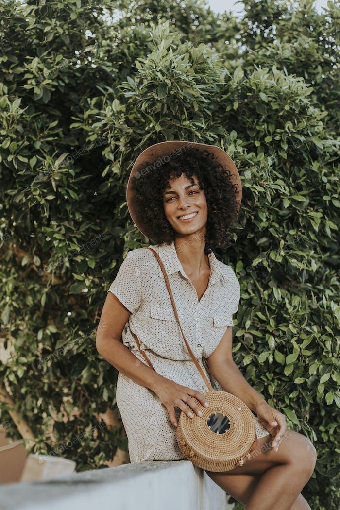 Beautiful woman at a botanical garden