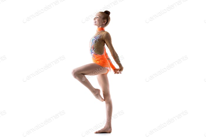 Teenage ballerina girl working out