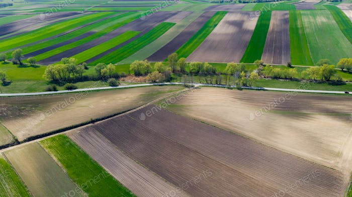 Agricultural Farm Fields Shapes. Aerial Drone view of Farmlands in Countryside