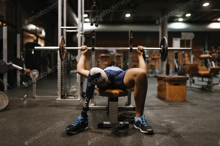 Disabled young man training in the gym