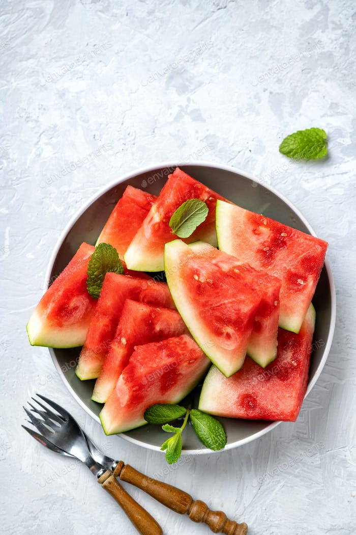 Watermelon pieces on light background
