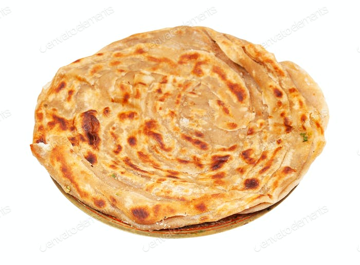 lachha paratha flatbread on brass plate isolated
