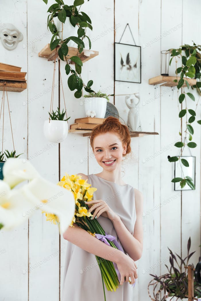 Woman with beautiful yellow bouquet looking camera