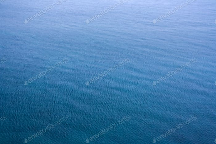 Abstract natural calm blue sea waves background