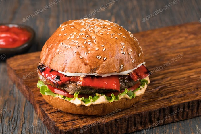 Burger on a wooden board
