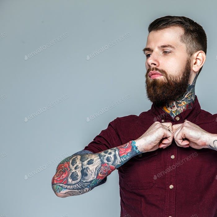 Brutal handsome man with tattoos on his body