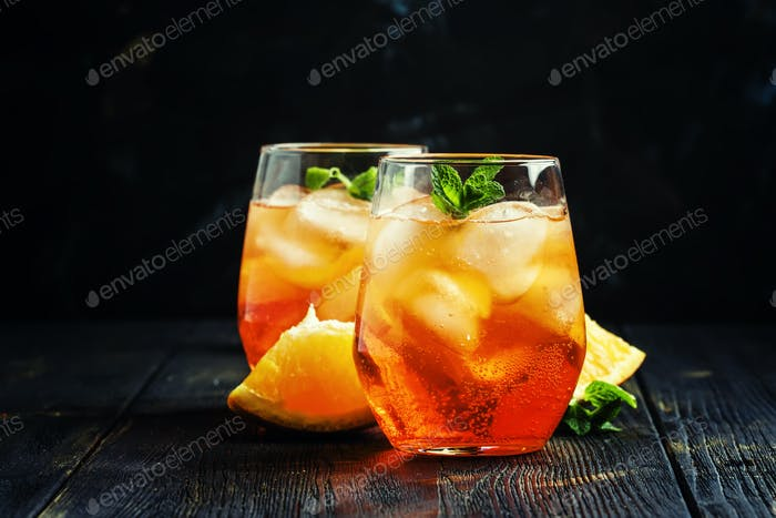 Italian cocktail with aperitif, ice and orange