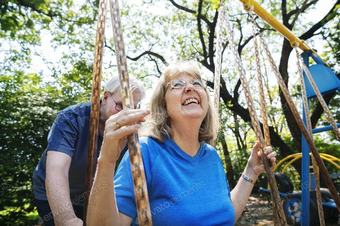 Senior couple playing at a playground