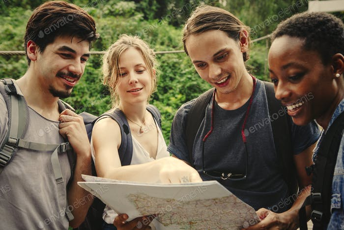 Friends finding their way in nature with a map