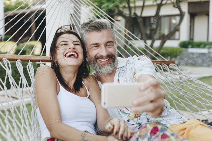 Couple taking a selfie while on vacation