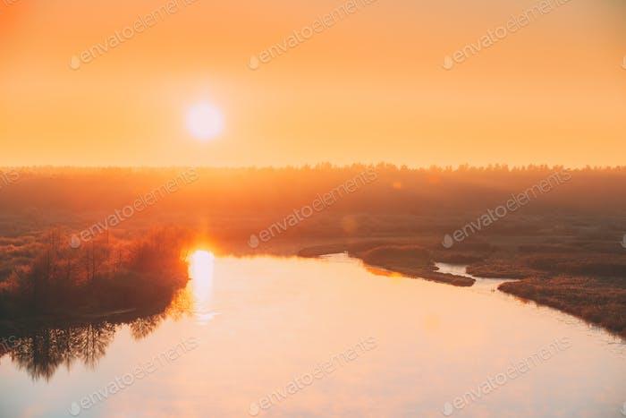 Beautiful Sunrise over Calm Lake, River in autumn morning. Sunse