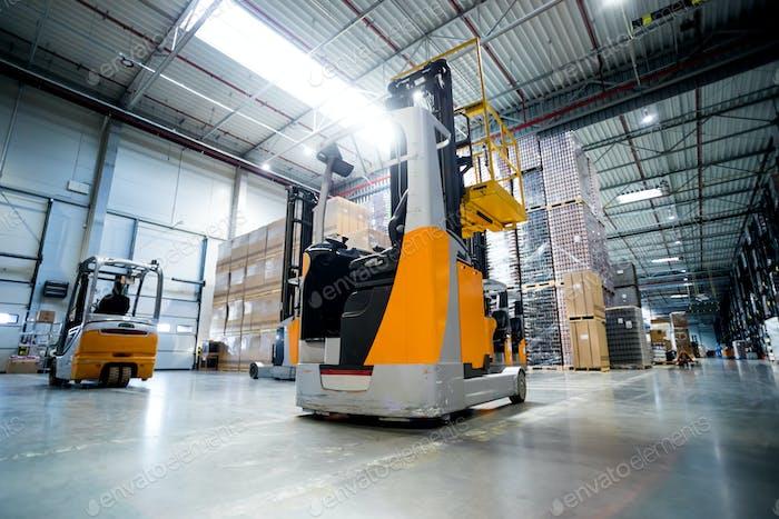 Forklift in huge warehouse