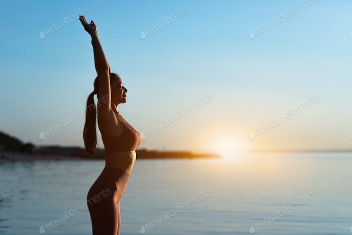 Girl preparing for cardio workout, stretching hands
