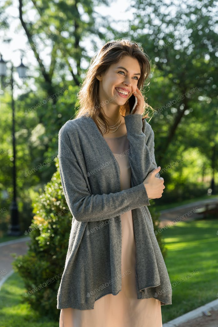 Happy young woman outdoors in park