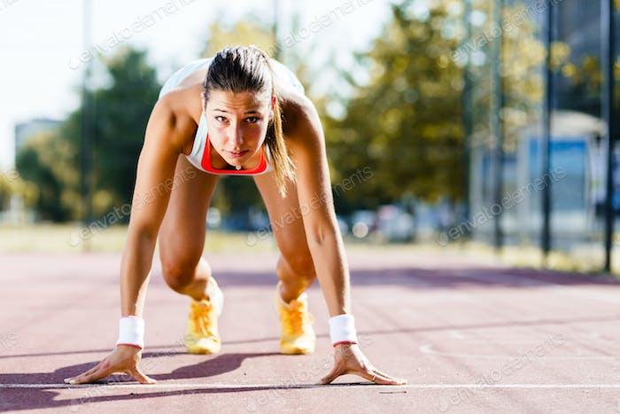 Female sprinter getting ready for the run