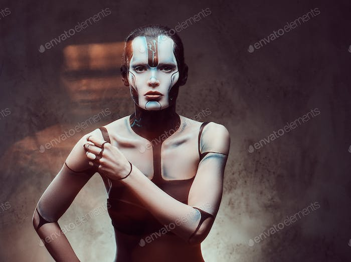 Sensual cyber woman. Technology and future concept. Isolated on a dark textured background.