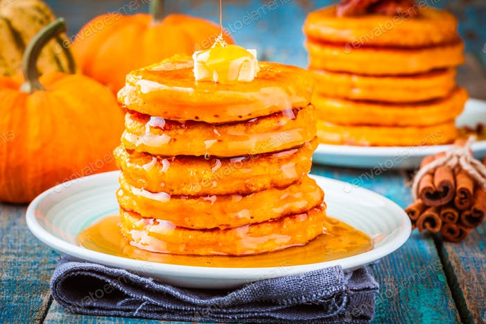 Pumpkin pancakes with honey and butter