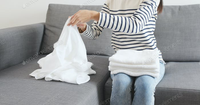 Wife folding white towel