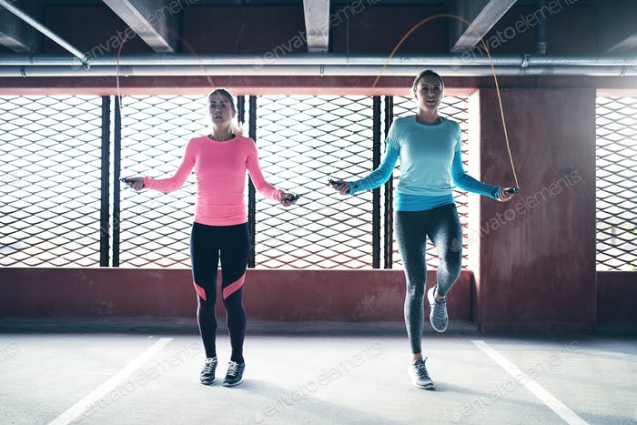 Sporty women doing jumping rope