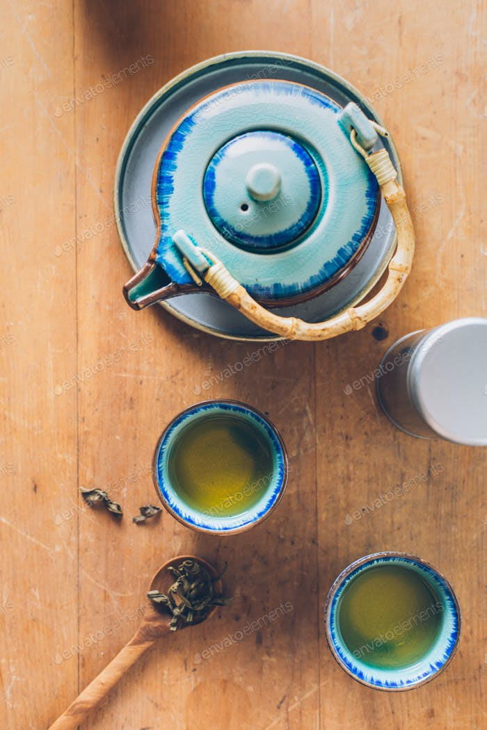 Freshly brewed green tea in small cups