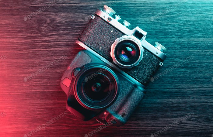 Old and new camera. Concept of technology progress. Blue and red light
