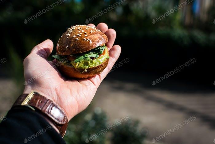 Beef slider in hand
