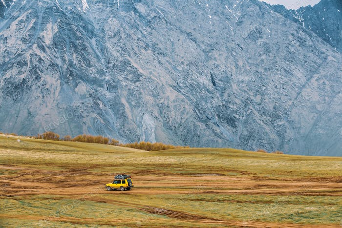 Yellow SUV Car On Off Road In Spring Mountains Landscape. Drive