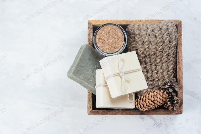 Spa, beauty skincare body concept. Handmade soap, coffee body scrub and body brush in wooden box