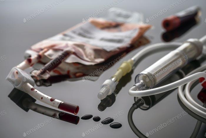 Empty blood Bag next to dropper, conceptual image